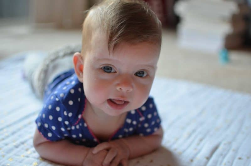 My little Ella is four months old! Here's what she's up to - just the sweetest addition to our family!
